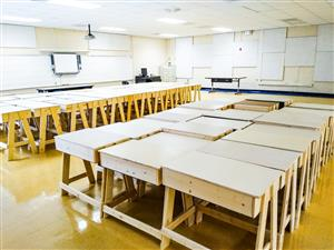 built desks lined up in a CHS classroom